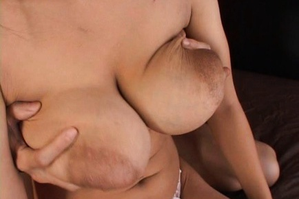 Japanese babe has big milky tits