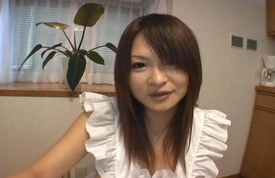 Ayumi Ayukawa Hot Asian model shows her tits in the kitchen